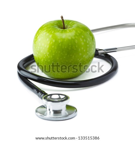 Green Apple Granny Smith with medical stethoscope isolated on white background for healthy eating - stock photo