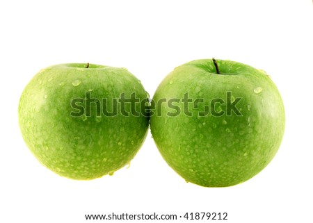 Green apple in drops on  white background, it is isolated.
