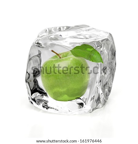 Green apple in ice on white background