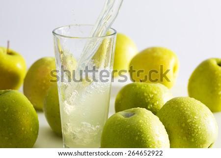 Green apple juice splash - stock photo