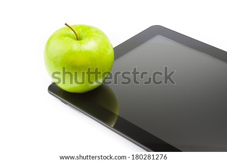 green apple on digital tablet pc on white background with space for text, concept of learn new technology