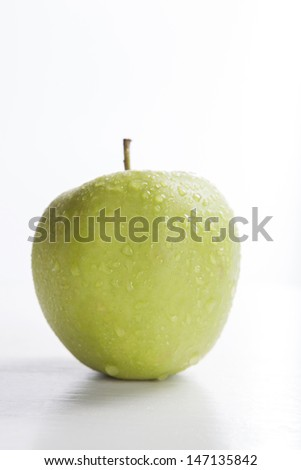 green apple on white background, with selective focus