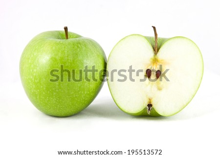 Green apple portion on white background - stock photo