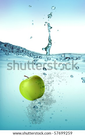 Green apple splashing into water - stock photo