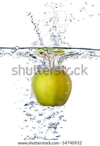 green apple splashing into water isolated on white background