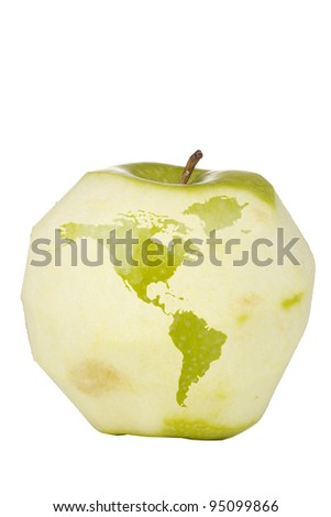 Green apple with a carving of the world map isolated on a white background. - stock photo