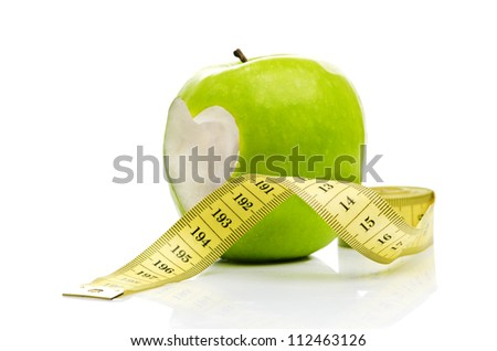 green apple with a heart symbol against white background