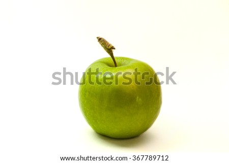 Green apple with a tail on a white background
