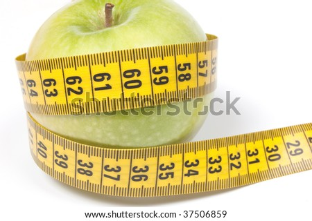 Green Apple with measuring tape, isolated on white. Diet concept