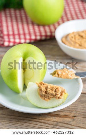 Green apple with peanut butter.