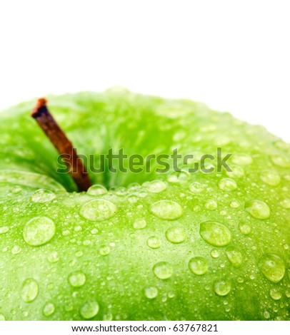 Green apple with water drops - stock photo