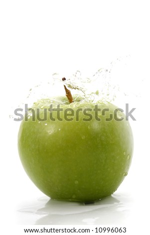 green apple with waterdrops, white background