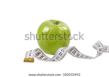 Green Apple With White measuring tape, isolated on white
