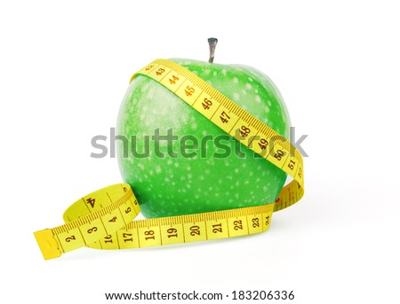Green apple with yellow measuring tape, isolated on white - stock photo