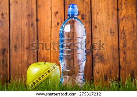 Green apples and bottle of water
