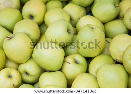 Green apples at a street market