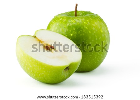 Green apples Ganny Smith covered in water droplets isolated against a white background.