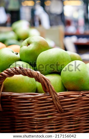 Green apples in a basket at the market - stock photo