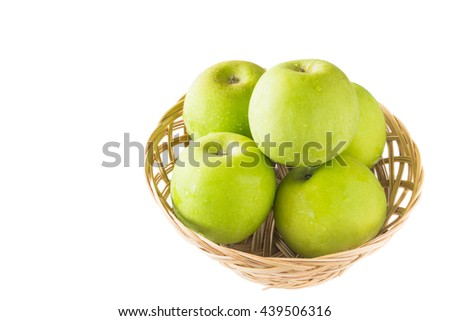 green apples in basket on white background - stock photo