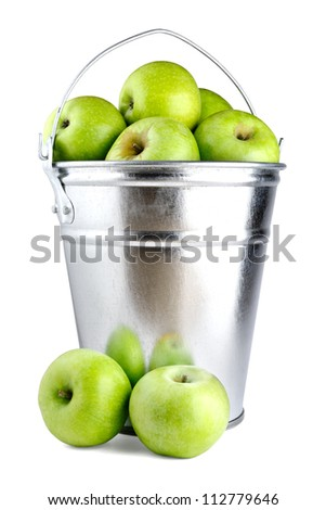 Green apples in bucket isolated on white background - stock photo
