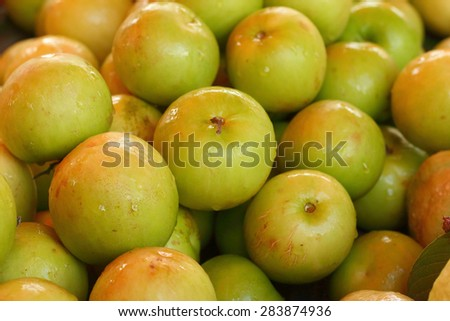 Green apples on a table at the market - stock photo