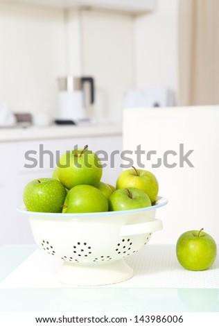 Green apples on the  white luxurious kitchen - stock photo