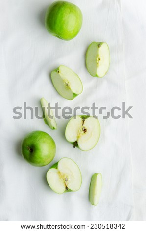 Green apples over white cloth, above view - stock photo