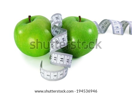 Green apples with  measurement tape  on a white background