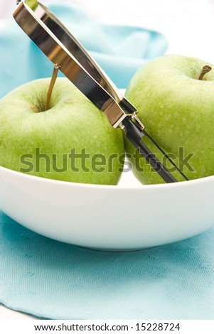 green apples with peeler