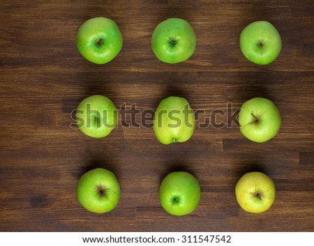 green appples on dark wooden background. Top view. - stock photo