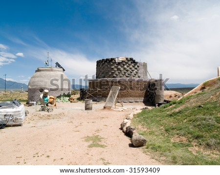 Green architecture - earthship under construction in Taos County, NM. - stock photo