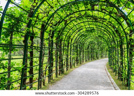 Green archway in a garden of the Linderhof Palace, Germany. - stock photo