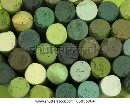green artistic crayons background - stock photo