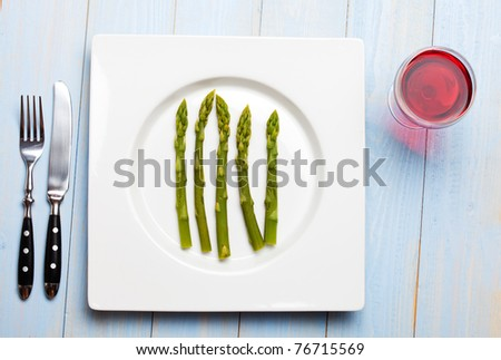 green asparagus on a white plate - stock photo