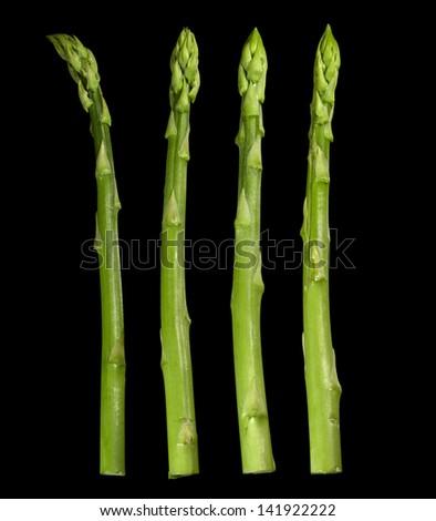 green asparagus vegetable in black back - stock photo