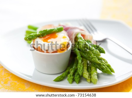 green asparagus with soft-boiled egg and  ham - stock photo