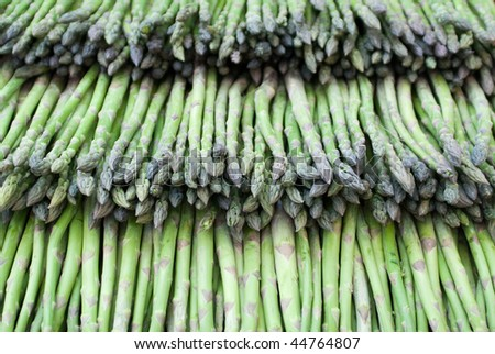 green asparaguses stacked for sale at a market - stock photo