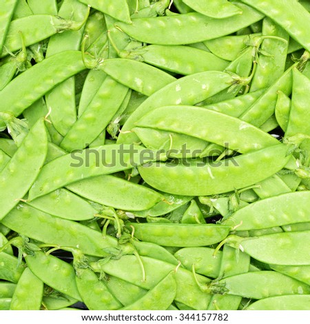 green background of young green peas  - stock photo
