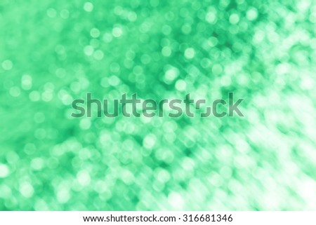 green background with bokeh. - stock photo
