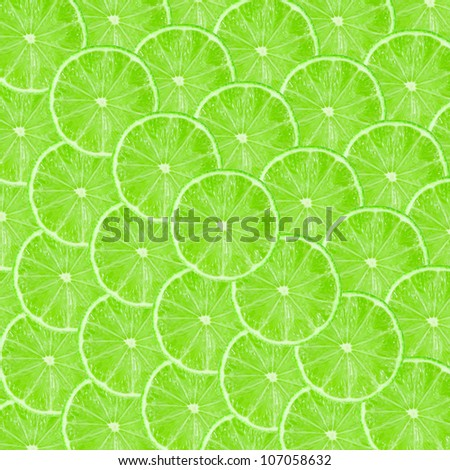 Green background with citrus fruit of lime slices