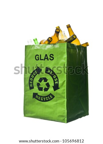 Green bag with glass recycling - stock photo