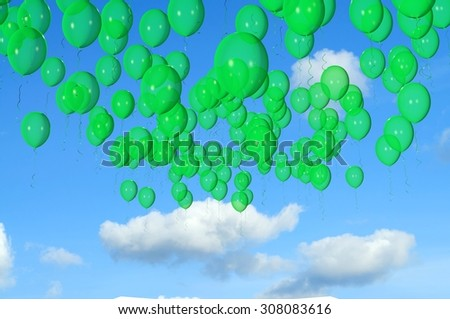 Green balloons flying in the sky - stock photo