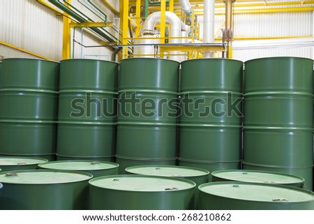 Green barrels or chemical drums stacked up - stock photo