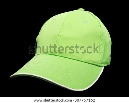 green baseball cap on black background, studio shot     - stock photo