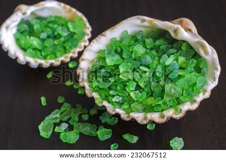 Green bath salt in a seashells - stock photo
