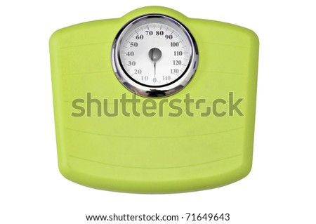Green bathroom scale isolated in white - stock photo