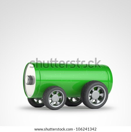 Green battery with car wheels - eco transport and mobility concept - stock photo