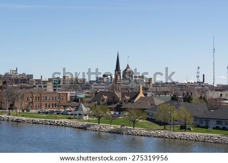 Green Bay, Wisconsin - April 27:  Downtown Green Bay view from Tilleman Bridge April 27, 2015.  - stock photo