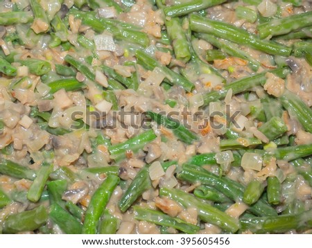 Green bean casserole is a casserole consisting of green beans, cream of mushroom soup, and french fried onions. It is a popular Thanksgiving side dish in the United States. - stock photo