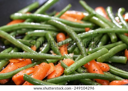 Green beans and carrots cooking in skillet - stock photo